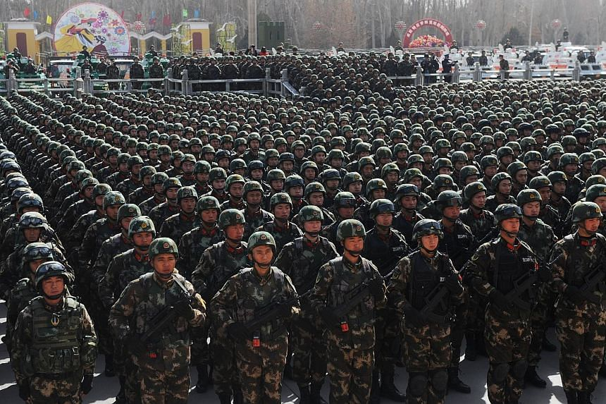 Chinese paramilitary forces at an anti-terror rally in Xinjiang. The Uighur homeland has been the site of persistent clashes between the Han and Uighurs, who complain of repression and discrimination. An expert says this video marks the first time Ui