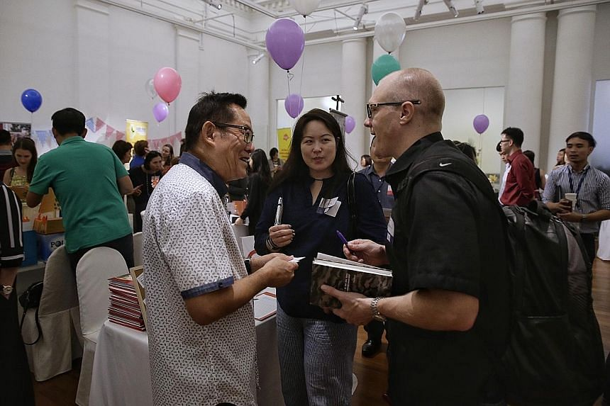 "Care Corner Singapore's Daniel Ong (in white) with Nike representatives Raena Cheong and Jordan Hanauer. Ms Cheong, whose company does not yet have a regular local charity partner, says the speed dating model for networking works ""because Singapore h"