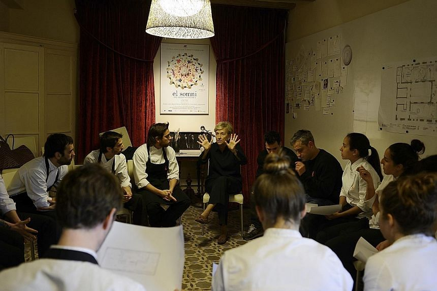Psychologist Imma Puig (centre) at a group therapy session at Spanish restaurant El Celler de Can Roca.