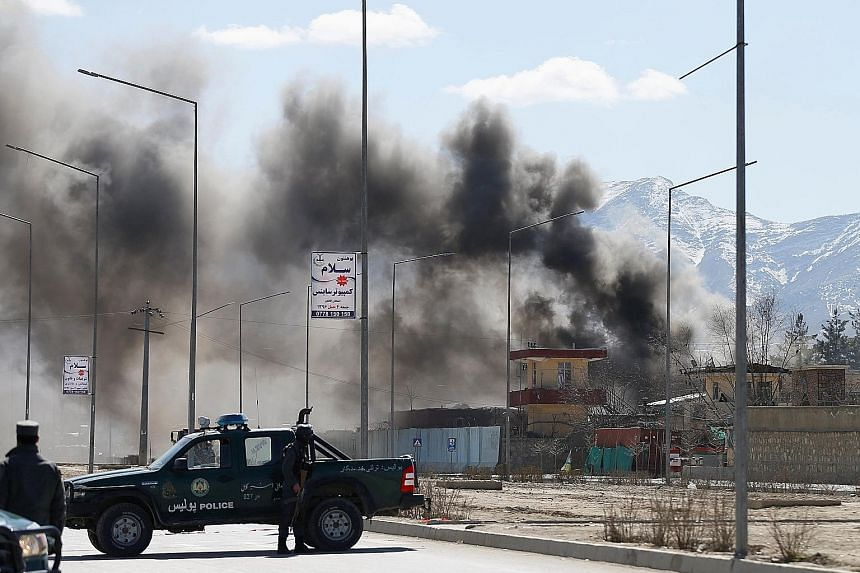 The site of a blast and gunfire between the Taleban and Afghan forces in Police District 6, in Kabul, yesterday. One militant was barricaded inside the police HQ there.