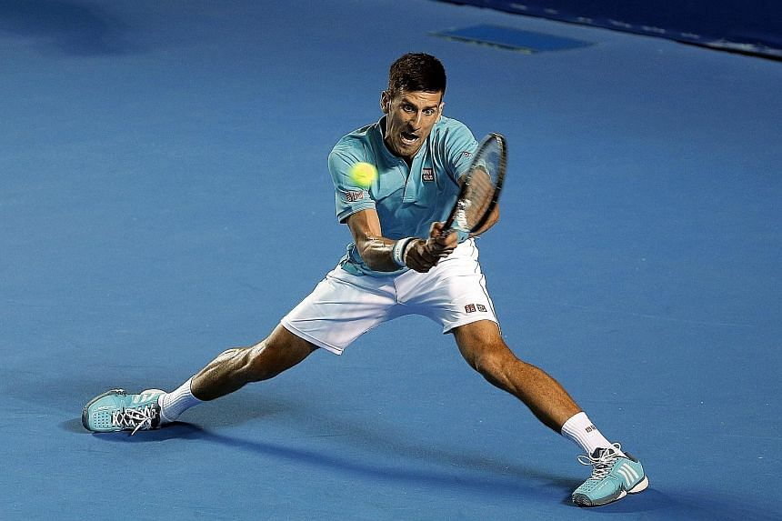 World No. 2 Novak Djokovic stretches to hit a backhand against Slovak Martin Klizan at Acapulco. The Serb hit just nine winners in his straight-sets win - 16 fewer than Klizan. But he made only 11 unforced errors, compared to 30 by the southpaw.