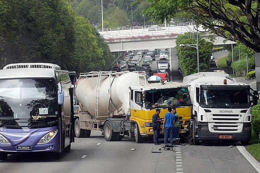 Two trucks collided along the Pan-Island Expressway (PIE) near the Stevens Road exit yesterday afternoon. The Singapore Civil Defence Force (SCDF) said it was alerted to the accident at about 3.35pm and dispatched an ambulance to the scene. A man in