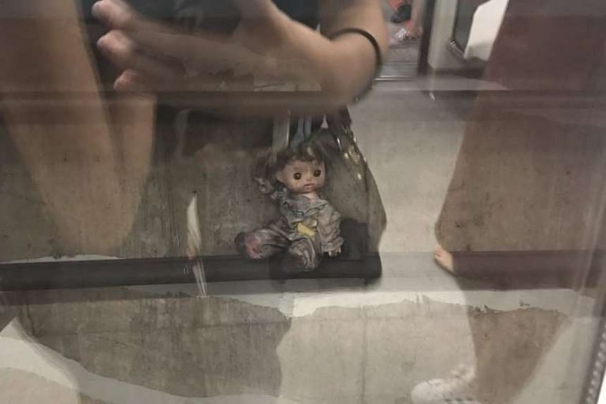 The doll perched on a ledge in one of Dhoby Ghaut MRT station's tunnels.