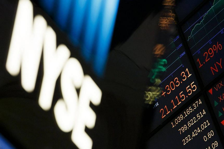 A board showing the Dow Jones industrial average is seen at the New York Stock Exchange.