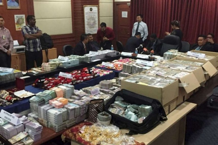 Cash and valuables seized by the Malaysian Anti-Corruption Commission from two officials in Malaysia's Sabah Water Department, in October 2016.