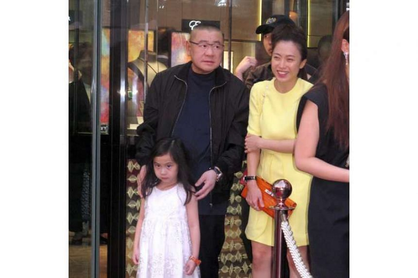 Chan Hoi Wan (right) with her then-boyfriend Joseph Lau and their daughter Josephine in Hong Kong in 2014.