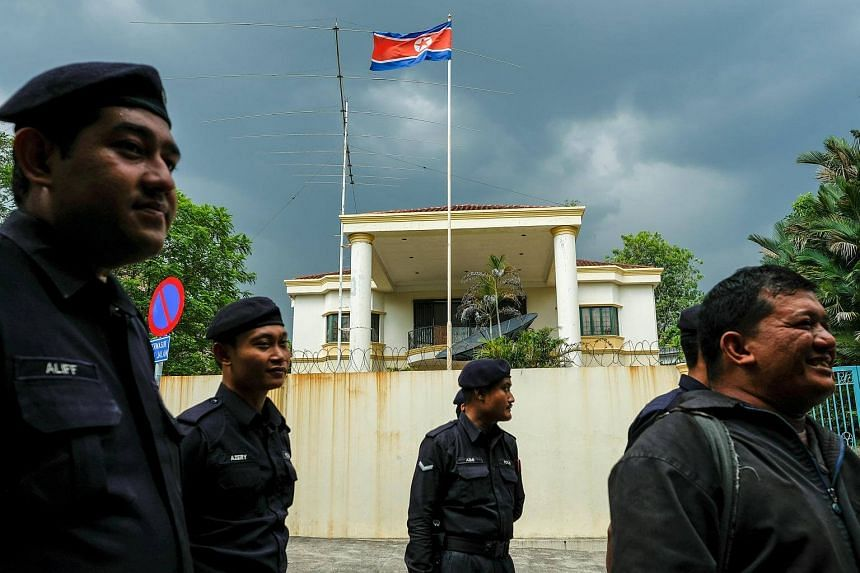 Malaysian police officers in front of the North Korea embassy before the start of a protest by Members of the youth wing of the National Front, Malaysia's ruling coalition.