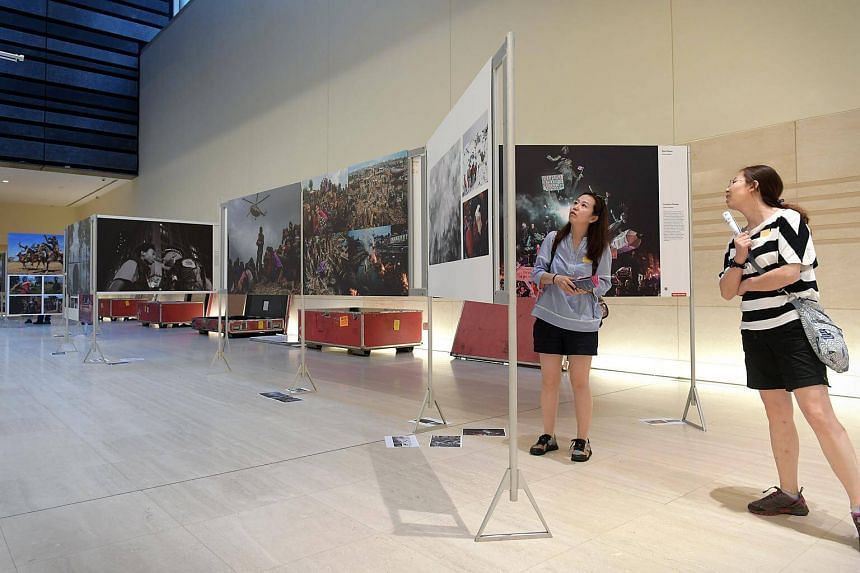 Visitors to the National Museum got a sneak peek of part of the touring the World Press Photo 2016 exhibition.