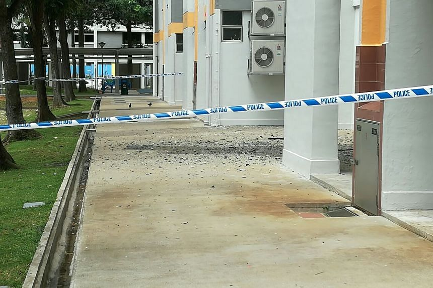 Debris from the 12th-floor fire at the base of Block 220, Serangoon Avenue 4.