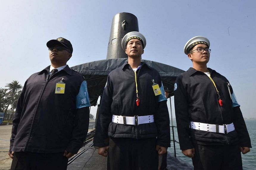 Taiwanese sailors in front of a submarine at the Tsoying navy base in Kaohsiung, southern Taiwan, on Jan 18, 2017.