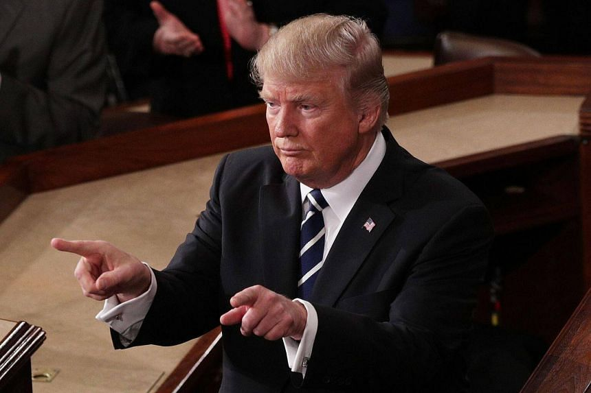 US President Donald Trump addressing a joint session of the US Congress on Feb 28, 2017, in the House chamber of the US Capitol in Washington, DC.