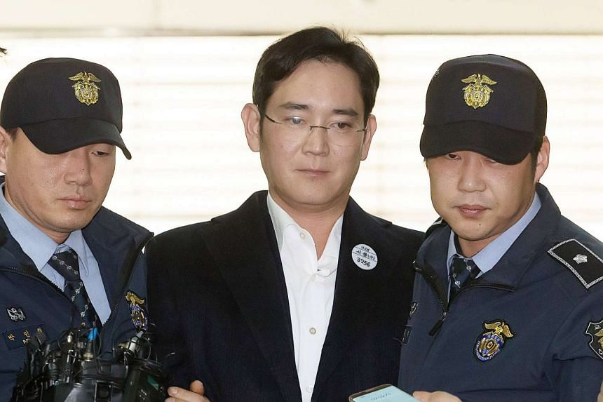 Lee Jae-yong (centre) arrives at the office of the Independent Counsel for questioning in Seoul, South Korea, on Feb 18, 2017.