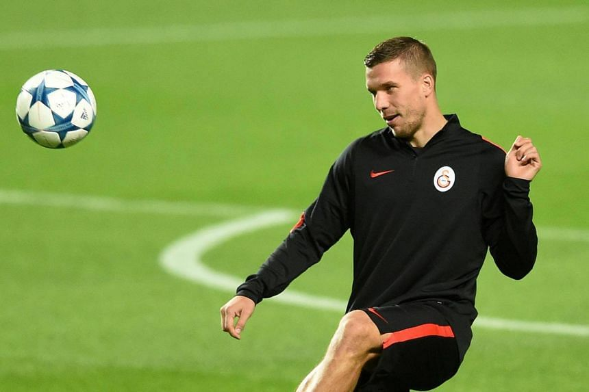 Galatasaray's German forward Lukas Podolski controling the ball during a training session at Luz stadium in Lisbon, on Nov 2, 2015.