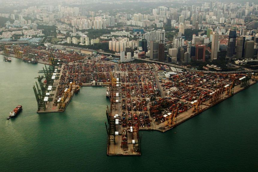 An aerial view of shipping containers stacked at the port of Singapore.