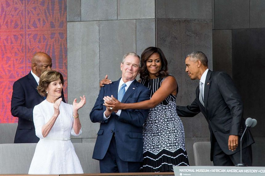 (From left) Former US First Lady Laura Bush, former US President George W. Bush, First Lady Michelle Obama, and President Barack Obama attend the opening ceremony for the Smithsonian National Museum of African American History and Culture, on Sept 24