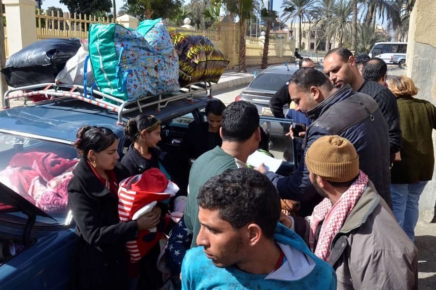 Christian families who left Arish arrive at the Evangelical Church in Ismailia, Egypt, Feb 24, 2017.