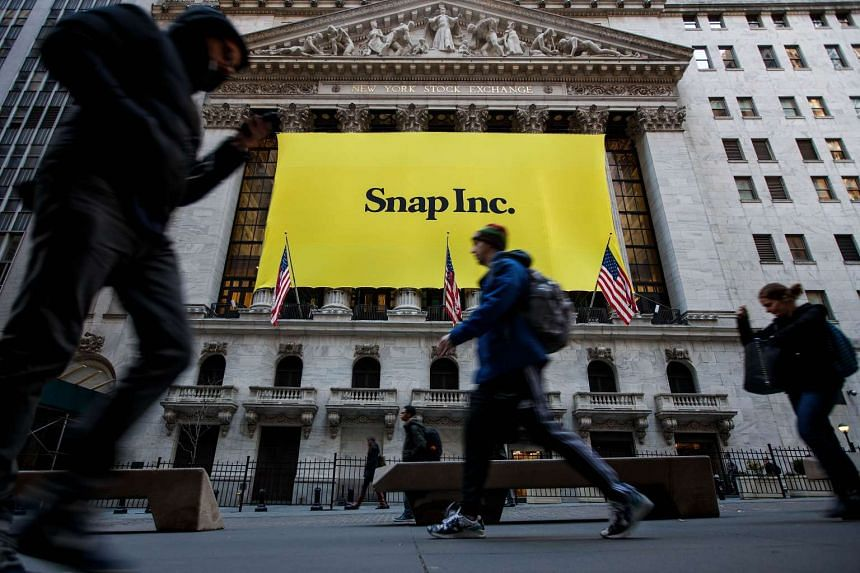 Signage for Snap Inc, the parent company of Snapchat, adorns the front of the New York Stock Exchange, March 2, 2017.