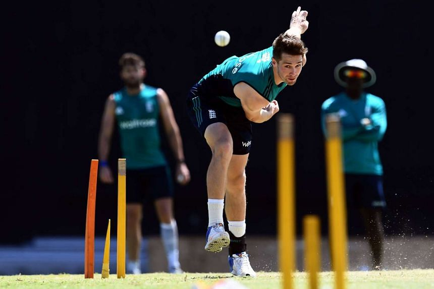 England's Chris Woakes delivering a ball during a practice session at the Sir Vivian Richards Stadium in St. John's, Antigua, on March 2, 2017.