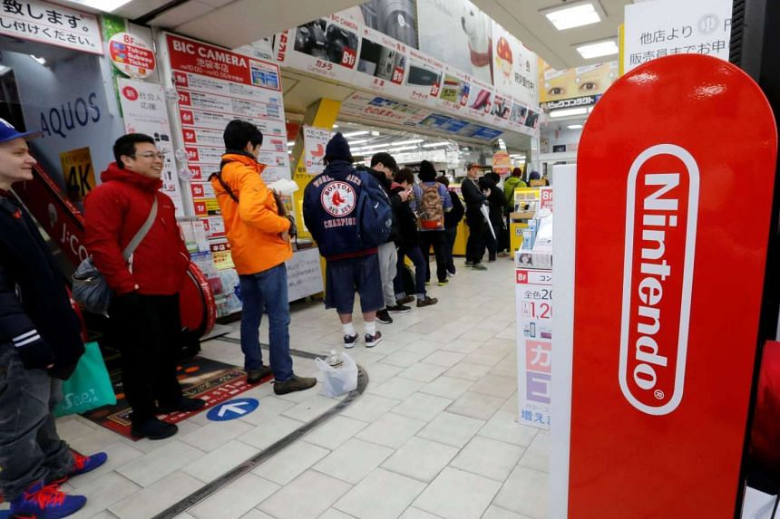 People lining up to get their hands on the Nintendo Switch game console at an electronics store in Tokyo, Japan, on March 3, 2017.