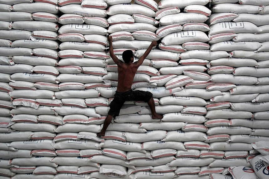 A National Food Authority warehouse stacked with bags of rice in Bicutan, in the Philippines. The South-east Asian country, which showed the fastest economic expansion last year, may be the first in the region to tighten monetary policy this year, sa