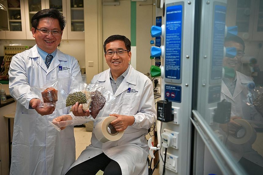 Examples of food stored in the packaging developed by the scientists and Dou Yee Enterprises, next to the same products in their normal packaging. Dou Yee Enterprises vice-president Alex Tan with food stored in the packaging, and senior scientist Li