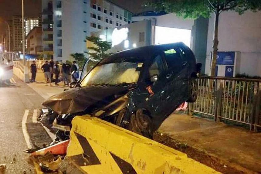 The driver of this car, reportedly a private-hire driver, escaped serious injury despite the damage to the car, which ended up between a roadside barrier and a walkway railing. Bystanders helped pull him out.