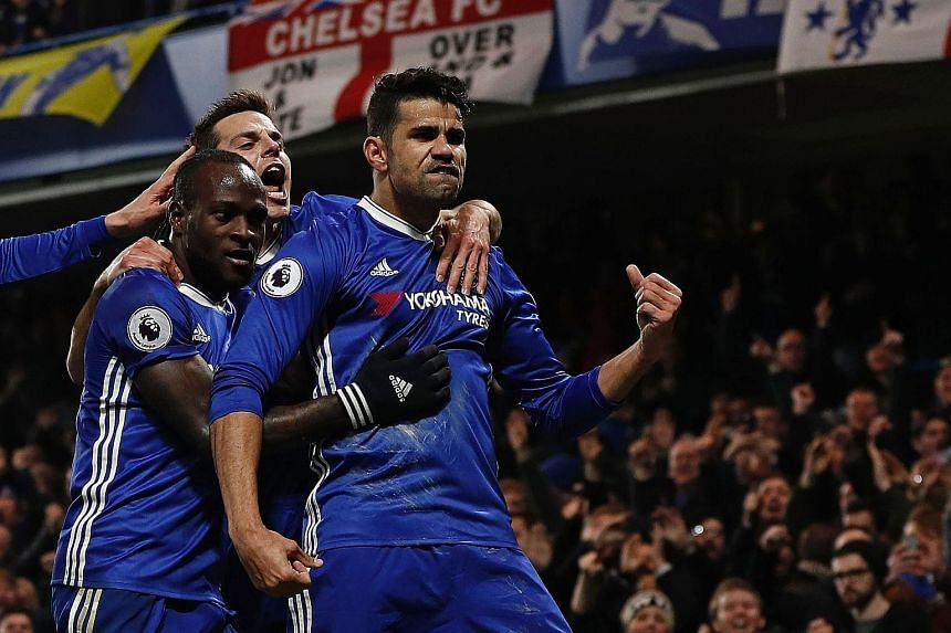 Striker Diego Costa (right), Chelsea's top scorer this season, celebrating one of his 16 Premier League goals this term. The Blues will play Premier League rivals Arsenal in Beijing on July 22 and could feature in Singapore that month.