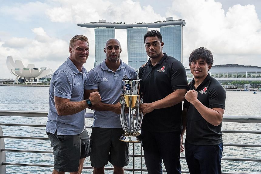From left: Kings' Ross Geldenhuys and Waylon Murray as well as Sunwolves' Uwe Helu and Junpei Ogura pose with the Super Rugby trophy at One Fullerton yesterday. The two sides meet tomorrow at the National Stadium, the first of three matches that the