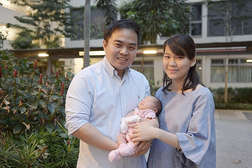 Public servants Roy Ng and Linda Wee welcomed their first child, Rheya, recently. Ms Wee said the extra four weeks of leave will come in useful while the couple wait for a space for their newborn girl at an infant-care centre near their home.