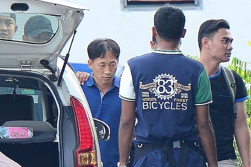 A North Korean (far left), identified by the Malaysian police as Mr Ri Jong Chol, being taken to a police station in Sepang on Feb 18.