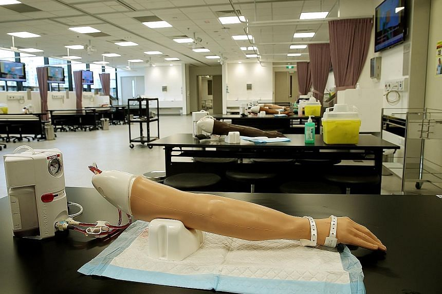 Equipped with prosthetic arms and other cutting-edge facilities, the practical skills laboratory at the Centre for Clinical Simulation gives students the opportunity to hone their skills. PhD student Divya Gunaseelan, 27, at one of the new facility's