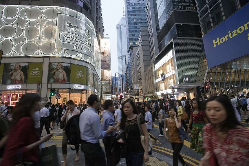 Pedestrians walking on Queen's Road in the Central district in Hong Kong, on May 17, 2012.