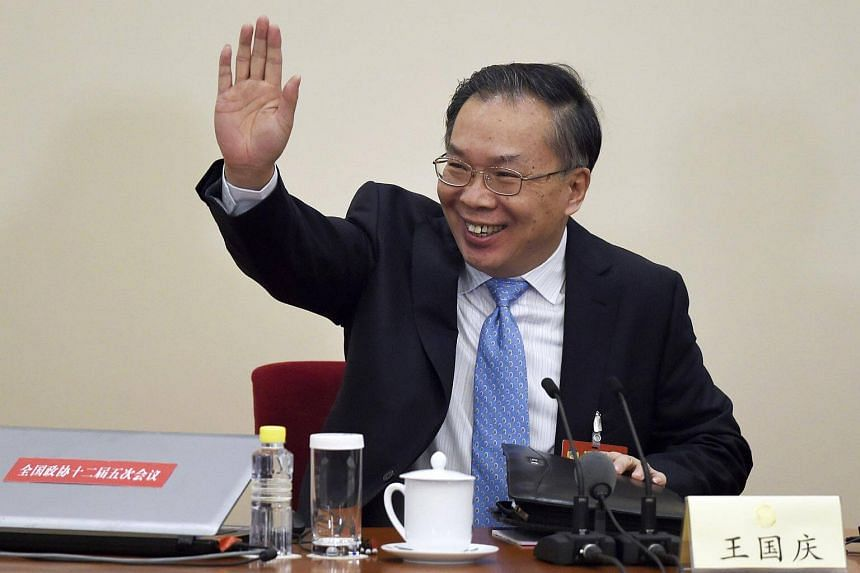 Mr Wang Guoqing, spokesman for the fifth session of the 12th Chinese People's Political Consultative Conference (CPPCC), waving as he arrives for a press conference at the Great Hall of the People in Beijing, on March 2, 2017.