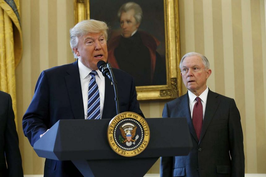 US President Donald Trump speaking during a swearing-in ceremony for new Attorney General Jeff Sessions (right) at the White House in Washington, on Feb 9, 2017.