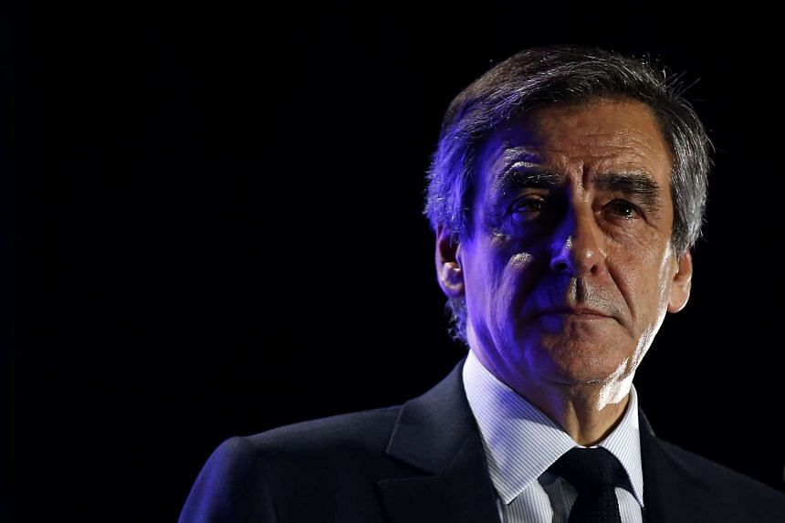 Francois Fillon looks on after delivering a speech at a presidential campaign rally in Nimes, Southern France on March 2, 2017.