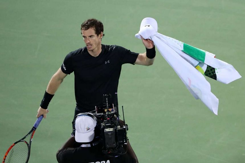 World number one Murray reacts after winning against Lucas Pouille.