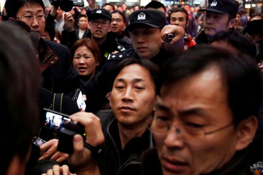 North Korean national Ri Jong Chol (centre) is surrounded by media after his arrival at Beijing airport, China, March 4, 2017.