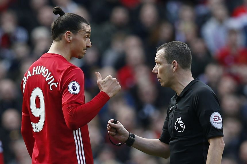 Manchester United's Zlatan Ibrahimovic speaks with referee Kevin Friend.