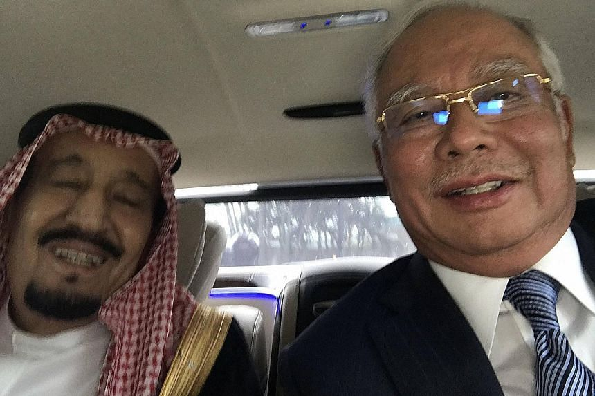 Saudi Arabia's King Salman has been in several light-hearted selfies on his Asian tour, such as this one with Malaysian Prime Minister Najib Razak during his first stop.