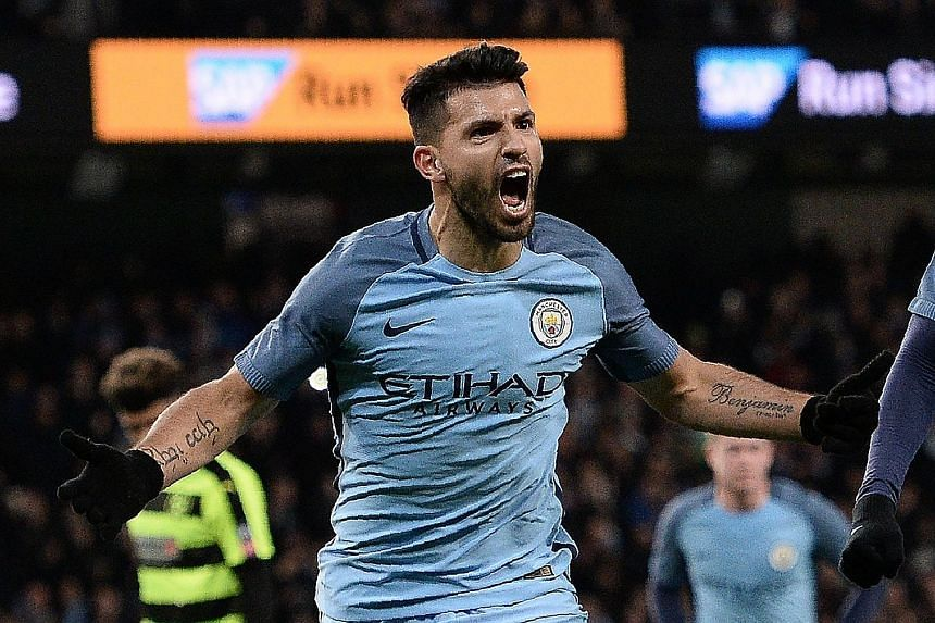 Man City striker Sergio Aguero celebrating his 73rd-minute goal and his side's fourth in the 5-1 FA Cup fifth-round replay rout over Championship team Huddersfield. City play away to Sunderland on Sunday in the Premier League as they aim to close the