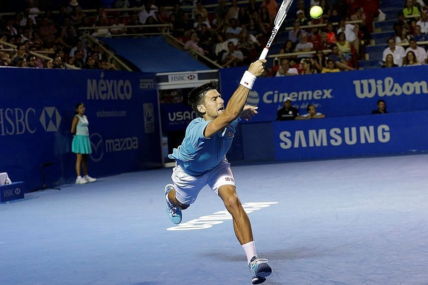 Novak Djokovic chases down a forehand against Nick Kyrgios in their Mexican Open quarter-final in Acapulco yesterday. Kyrgios served 25 aces to wrap up an 7-6 (11-9), 7-5 win. The mercurial Australian is now in his second ATP semi-final in just two w