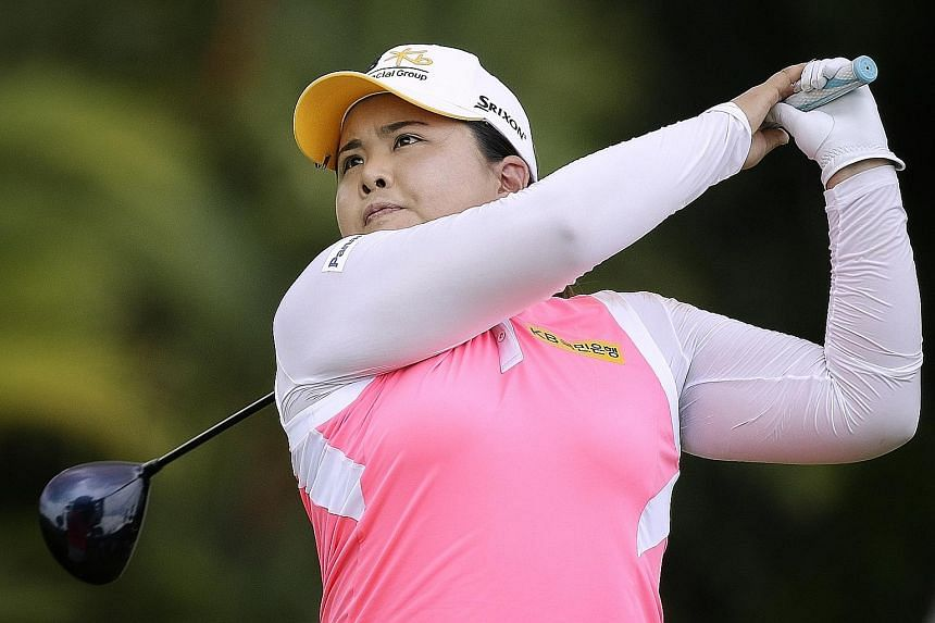 Park In Bee teeing off on the ninth hole during the second round of HSBC Women's Champions at the New Tanjong Course. Park carded a second straight five-under 67 to stay one ahead of a trio tied for second.