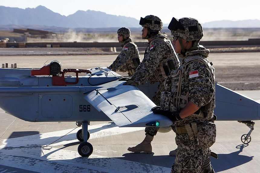 Singapore Armed Forces soldiers deploying an unmanned aerial vehicle as part of the UAV Task Group in Afghanistan in 2010. A robotics laboratory will be set up next month in the DSO National Laboratories to hone such technology.