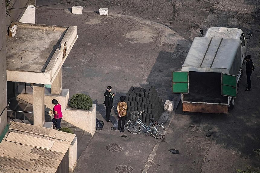 A shipment of coal brickettes in Pyongyang. China says its ban on coal imports from North Korea is in line with UN sanctions against the hermit state. Pyongyang's ban on mineral exports to China is only temporary, said a source.