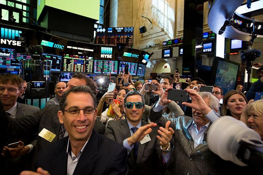 There's no better place to rock a pair of Snapchat Spectacles (Teal colour, centre) than on the floor of the New York Stock Exchange during the company's IPO on Thursday.