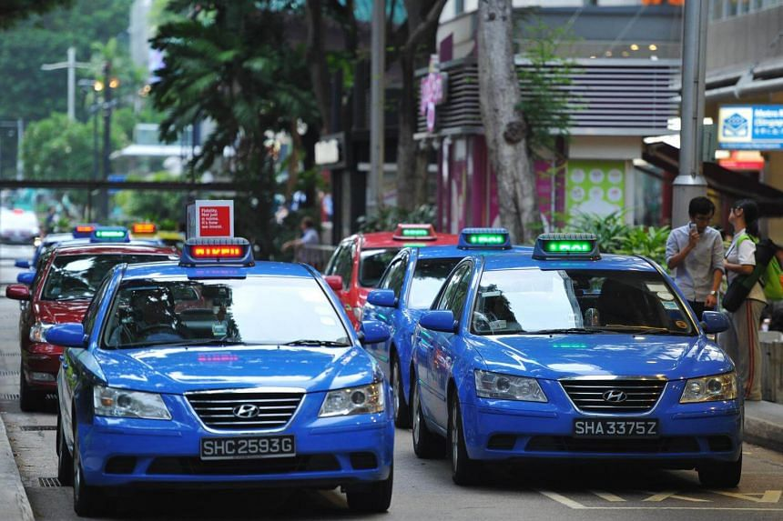 Taxis at the Lucky Plaza taxi stand.