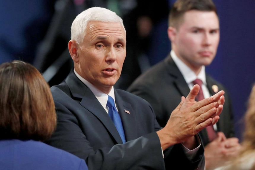 Republican US vice-presidential nominee Governor Mike Pence clapping as he talks to the audience at Longwood University in Farmville, Virginia, US, on Oct 4, 2016.