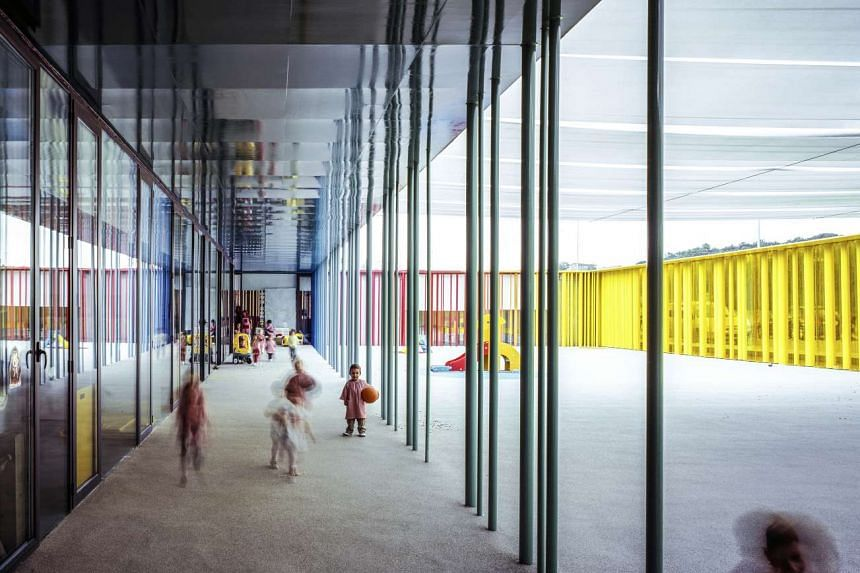 The El Petit Comte Kindergarten built in Besalu, Girona, Spain, in 2010. There are no walls or corridors in this creation - just colourful tubes arranged around the building's perimeter like colour pencils.