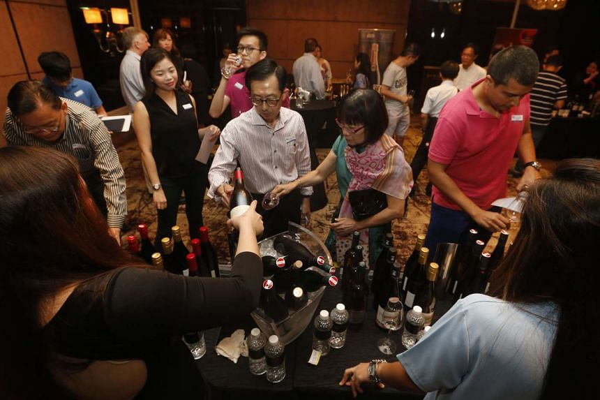 Visitors at the ST Wine Fair at The St Regis Singapore on March 4, 2017.