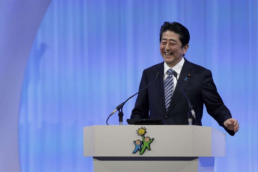 Japanese Prime Minister and President of the ruling Liberal Democratic Party Shinzo Abe smiles as he speaks at the party's 84th annual convention in Tokyo on March 5, 2017.